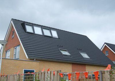 Baskapel op woonhuis dak